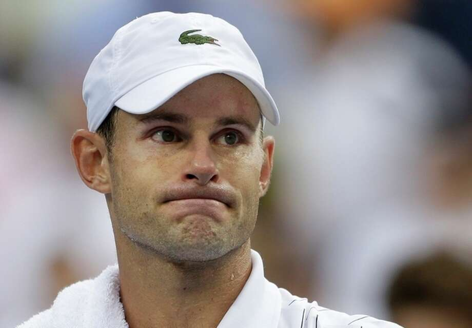Andy Roddick reacts after losing to Juan Martin Del Potro in the quarterfinals during the 2012 US Open tennis tournament, Wednesday, Sept. 5, 2012, in New York. Roddick said he would retire after the match. (AP Photo/Darron Cummings) / AP