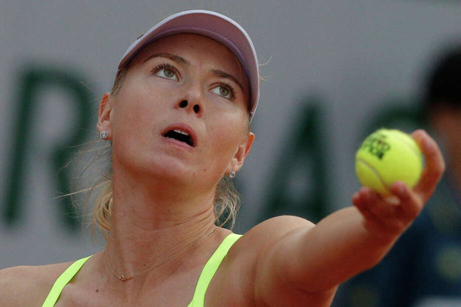 Russia's Maria Sharapova serves against Su-Wei Hsieh of Taipei in their first round match of the French Open tennis tournament, at Roland Garros stadium in Paris, Monday, May 27, 2013. (AP Photo/Michel Spingler) / AP