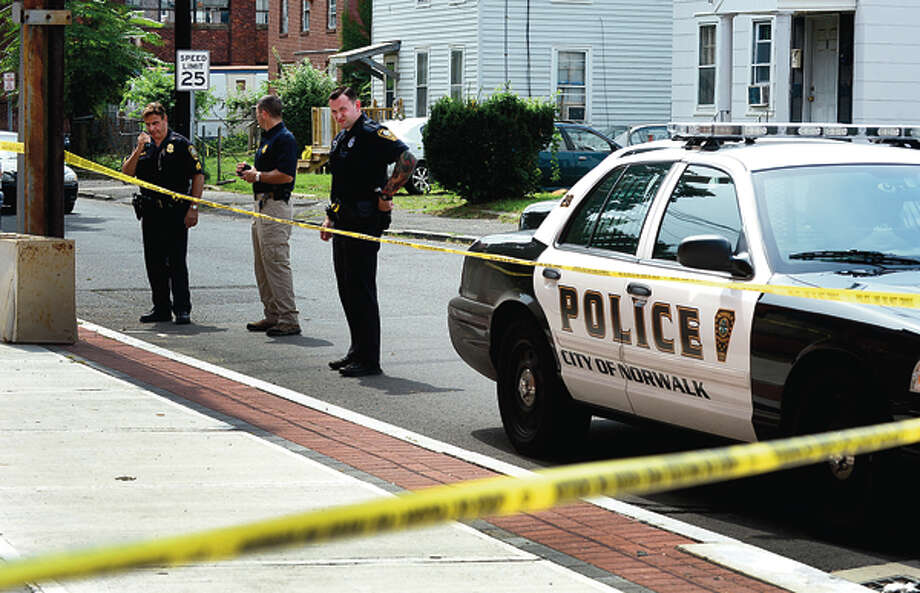 Norwalk police investigate the South Norwalk stabbing on Chesnut St Thursday . Hour photo / Erik Trautmann / (C)2012, The Hour Newspapers, all rights reserved