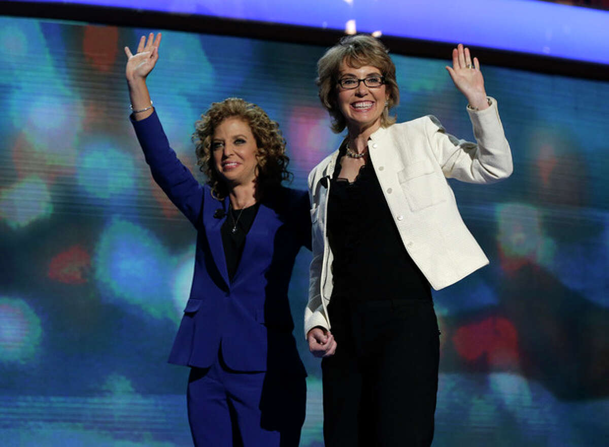 Former Rep. Gabrielle Giffords, right, reacts after reciting the Pledge of Allegiance with Democratic National Committee Chairwoman Rep. Debbie Wasserman Schultz of Florida at the Democratic National Convention in Charlotte, N.C., on Thursday, Sept. 6, 2012. (AP Photo/Charles Dharapak)