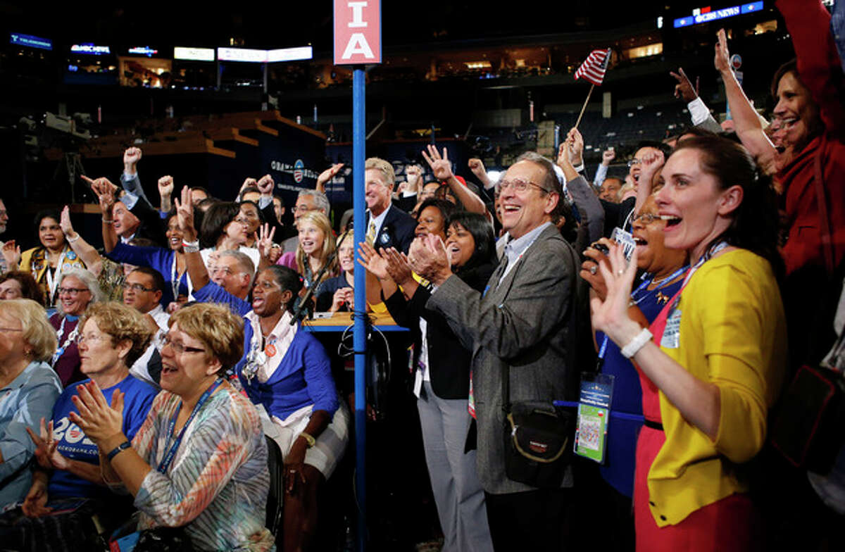 Virginia delegates react as President Barack Obama is nominated for the Office of the President of the United States at the Democratic National Convention in Charlotte, N.C., on Thursday, Sept. 6, 2012. (AP Photo/Jae C. Hong)