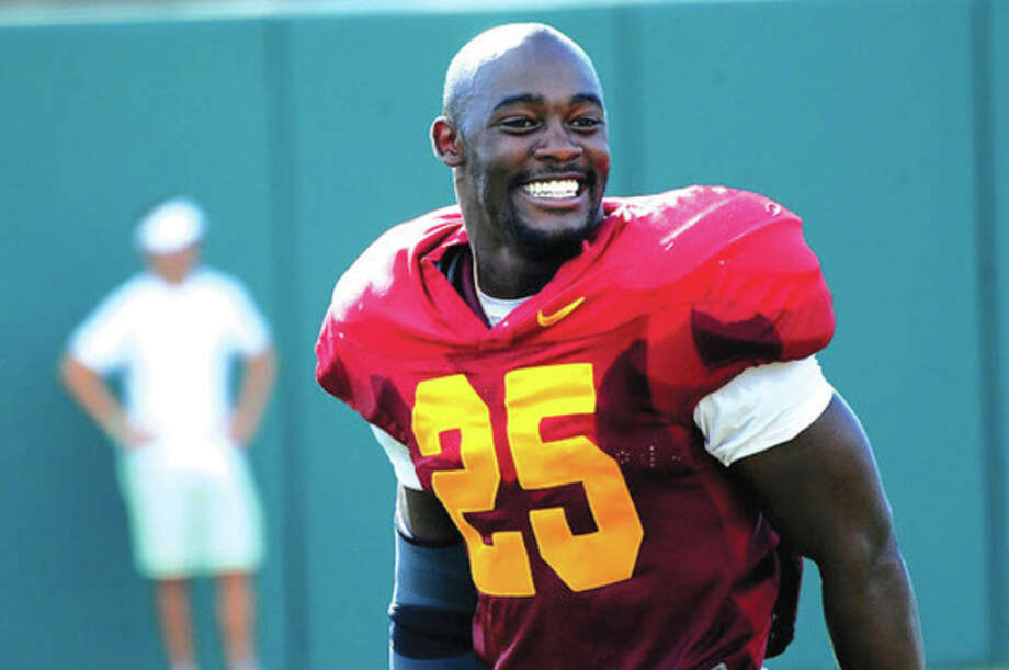 USC photoUSC running back Silas Redd is all smiles at a recent Trojans' practice. The Norwalk resident is coming East this weekend, when USC takes on Syracuse Saturday afternoon at MetLife Stadium in New Jersey. / JOHN_MCGILLEN
