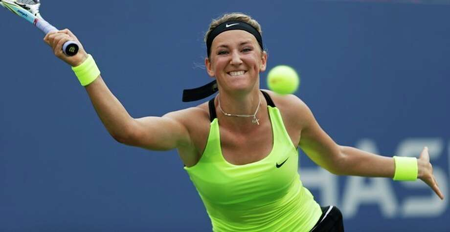 Victoria Azarenka, of Belarus, returns a shot to Samantha Stosur, of Australia, in the quarterfinals of the 2012 US Open tennis tournament, Tuesday, Sept. 4, 2012, in New York. Azarenka won the match. (AP Photo/Kathy Willens) / AP