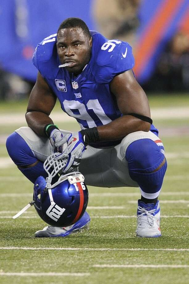 New York Giants defensive end Justin Tuck (91) reacts during the second half of an NFL football game Wednesday, Sept. 5, 2012, in East Rutherford, N.J. The Giants lost the game 24-17. (AP Photo/Bill Kostroun)
