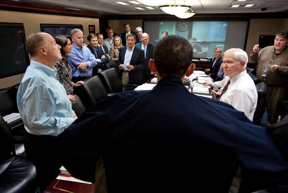 """FILE – In this May 1, 2011, file photo released by the White House, President Barack Obama talks with members of the his national security team in the White House Situation Room during one in a series of meetings to discuss the mission against Osama bin Laden. As the world now knows well Obama ultimately decided to launch the raid on the Abbottabad compound that killed bin Laden, though faced with a level of widespread skepticism from a veteran intelligence analyst, skepticism shared with other top-level officials, which nearly scuttled the raid. That process reflected a sea change within the U.S. spy community, one that embraces debate to avoid """"slam-dunk"""" intelligence in tough national security decisions. (AP Photo/The White House, Pete Souza, File) / The White House"""