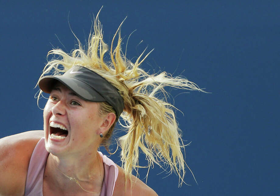 Maria Sharapova, of Russia, serves to Victoria Azarenka, of Belarus, during a semifinal match at the 2012 US Open tennis tournament, Friday, Sept. 7, 2012, in New York. (AP Photo/Darron Cummings) / AP