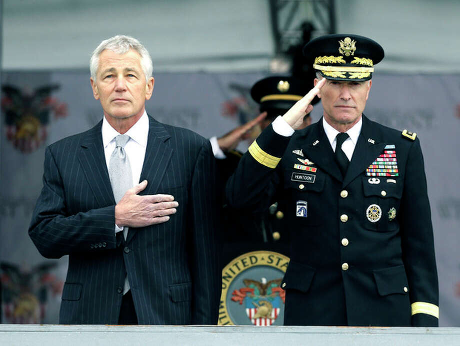 Defense Secretary Chuck Hagel, left, and Superintendent Lt. Gen. David Huntoon, Jr., stand for the national anthem during a graduation and commissioning ceremony at the U.S. Military Academy in West Point, N.Y. on Saturday, May 25, 2013. (AP Photo/Mike Groll) / AP