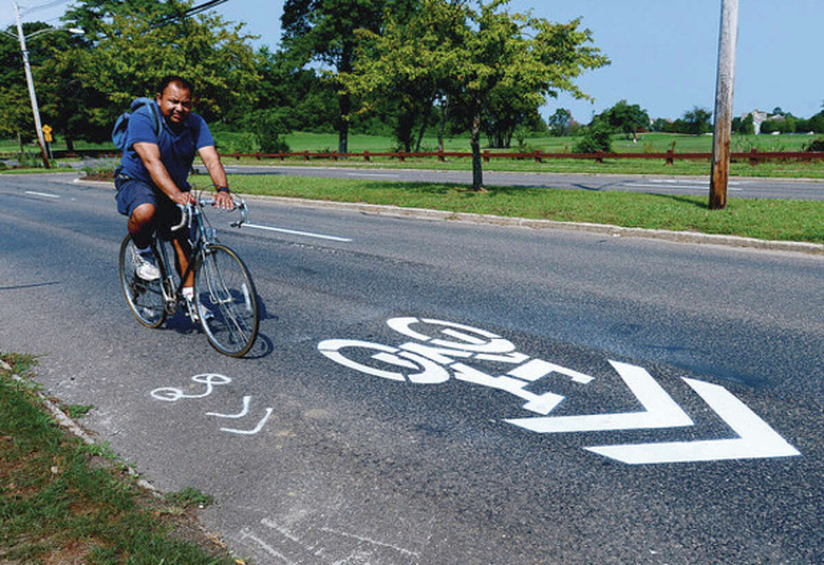 Hour photo / Erik Trautmann The city has added new signage and road paint on Beach Road asking drivers to share Norwalk roads with bicylists.