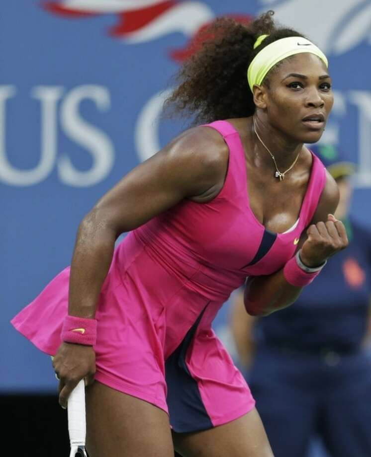 Serena Williams reacts during her match against Italy's Sara Errani during a semifinal match at the 2012 US Open tennis tournament, Friday, Sept. 7, 2012, in New York. (AP Photo/Darron Cummings)