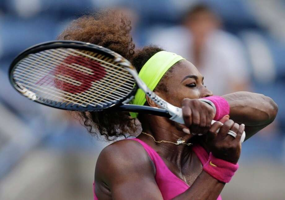 Serena Williams returns a shot to Italy's Sara Errani during a semifinal match at the 2012 US Open tennis tournament, Friday, Sept. 7, 2012, in New York. (AP Photo/Charles Krupa) / AP