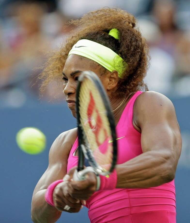 Serena Williams returns a shot to Italy's Sara Errani during a semifinal match at the 2012 US Open tennis tournament, Friday, Sept. 7, 2012, in New York. (AP Photo/Darron Cummings) / AP
