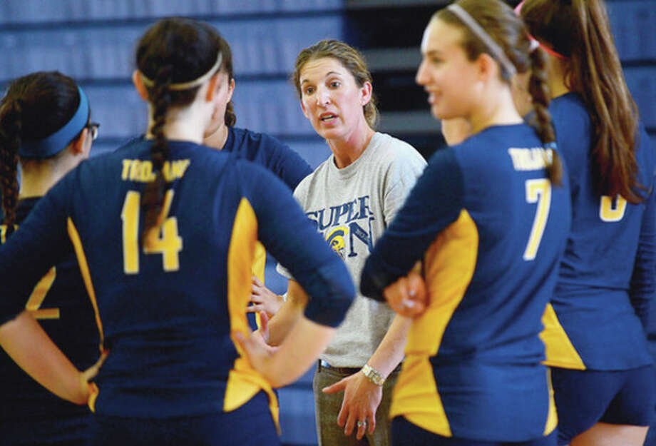 Hour photo/Erik TrautmannWeston High School volleyball coach Jamie Charles, center, gives her players instructions before a scrimmage against Staples Thursday. Under Charles, the Trojans have made nine consecutive SWC tournaments and are regulars in state tournament play. According to the coach, it's all about getting the players to believe in themselves and helping them continue to get better. / (C)2012, The Hour Newspapers, all rights reserved