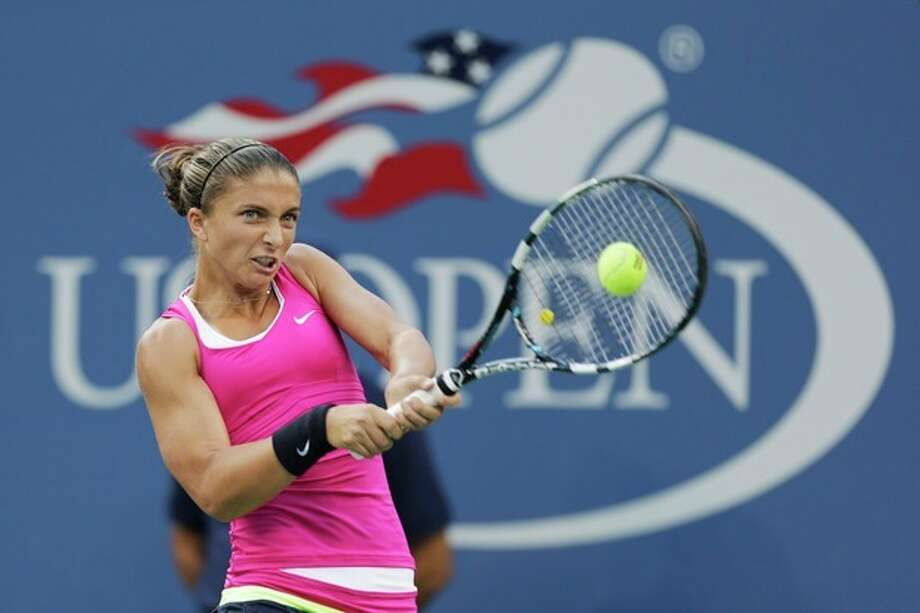 Italy's Sara Errani returns a shot to Serena Williams during a semifinal match at the 2012 US Open tennis tournament, Friday, Sept. 7, 2012, in New York. (AP Photo/Charles Krupa) / AP