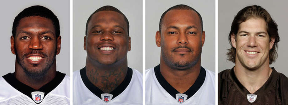 FILE - From left are NFL football players Jonathan Vilma, in 2011; Anthony Hargrove, in 2010; Will Smith, in 2011; and Scott Fujita, in 2011. The suspensions of four players in the NFL's bounty investigation have been lifted by a three-member appeals panel. The league reinstated those players a few minutes after Friday's, Sept. 7, 2012 ruling. While the ruling allows Saints linebacker Jonathan Vilma, Saints defensive end Will Smith, Cleveland linebacker Scott Fujita and free agent defensive lineman Anthony Hargrove to play immediately, it does not permanently void their suspensions (AP Photo/File) / AP