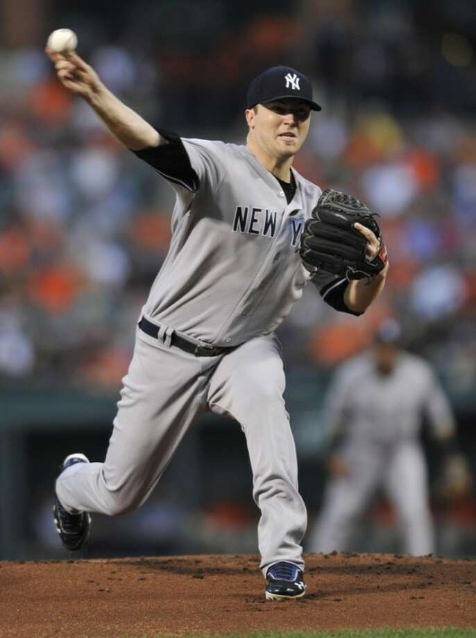 New York Yankees starting pitcher Phil Hughes delivers against the Baltimore Orioles in the first inning of a baseball game Friday, Sept. 7, 2012, in Baltimore. (AP Photo/Gail Burton)