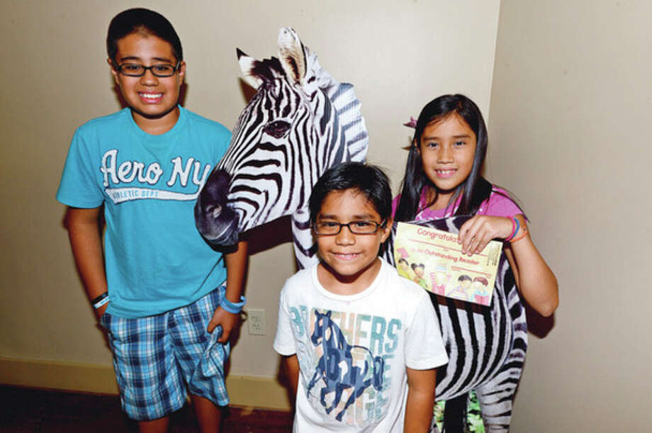 "Kevin, Kelsey and Axel Nava were recognized at The Summer Reading Certificate Ceremony and Back to School Kickoff celebration for children who completed the ""Summer Safari"" summer reading program at the Stew Leonard III Children's Library of the South Norwalk Branch Saturday.photo / Erik Trautmann / (C)2012, The Hour Newspapers, all rights reserved"