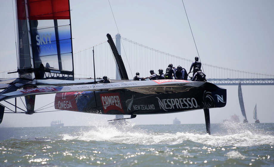 Emirates Team New Zealand train for the America's Cup with the San Francisco-Oakland Bay Bridge in the background Friday, May 24, 2013 in San Francisco. (AP Photo/Eric Risberg) / AP