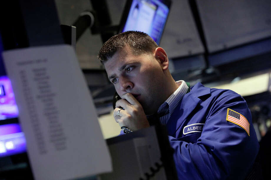 A specialist works on the floor of the New York Stock Exchange Friday, Sept. 7, 2012. Stocks are opening mixed on Wall Street following news that the U.S. economy added fewer jobs than expected in August. (AP Photo/Richard Drew) / AP