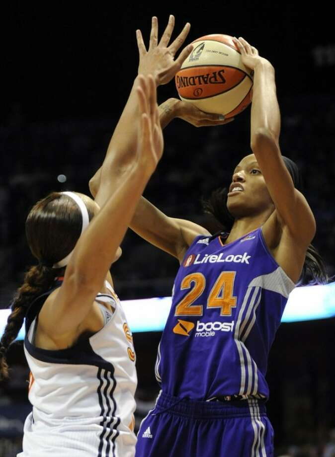 Phoenix Mercury's DeWanna Bonner (24) shoots over Connecticut Sun's Mistie Mims in the second half of a WNBA basketball game in Uncasville, Conn., Friday, Sept. 7, 2012. Bonner was top scorer for Phoenix with 35 points as Phoenix topped Connecticut 91-82. (AP Photo/Jessica Hill)