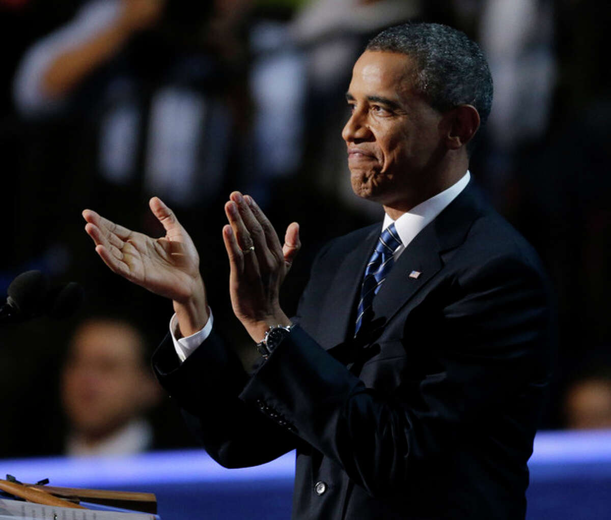 President Barack Obama applauds before his speech to the Democratic National Convention in Charlotte, N.C., on Thursday, Sept. 6, 2012. (AP Photo/Lynne Sladky)