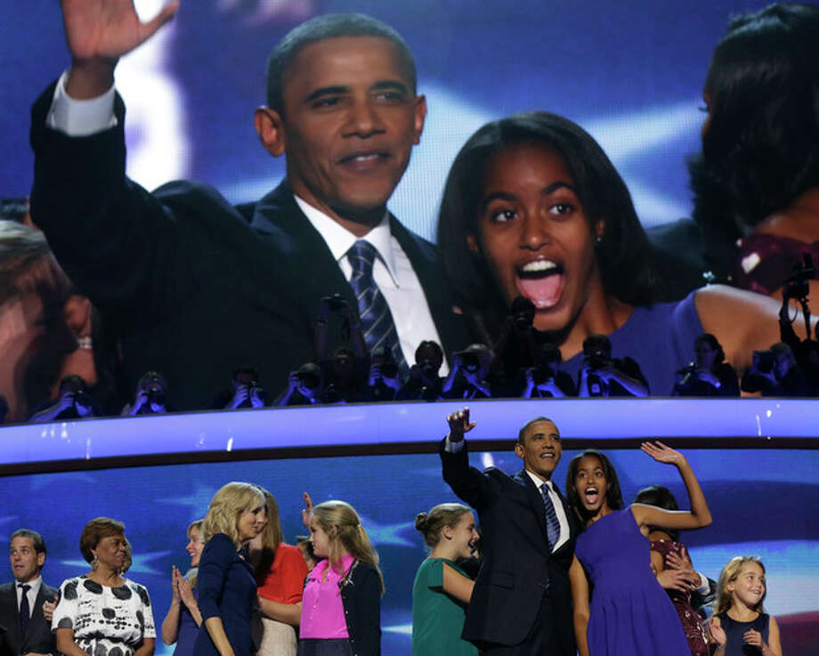 President Barack Obama and his daughter Malia wave after President Obama's speech to the Democratic National Convention in Charlotte, N.C., on Thursday, Sept. 6, 2012. (AP Photo/Charles Dharapak) / AP