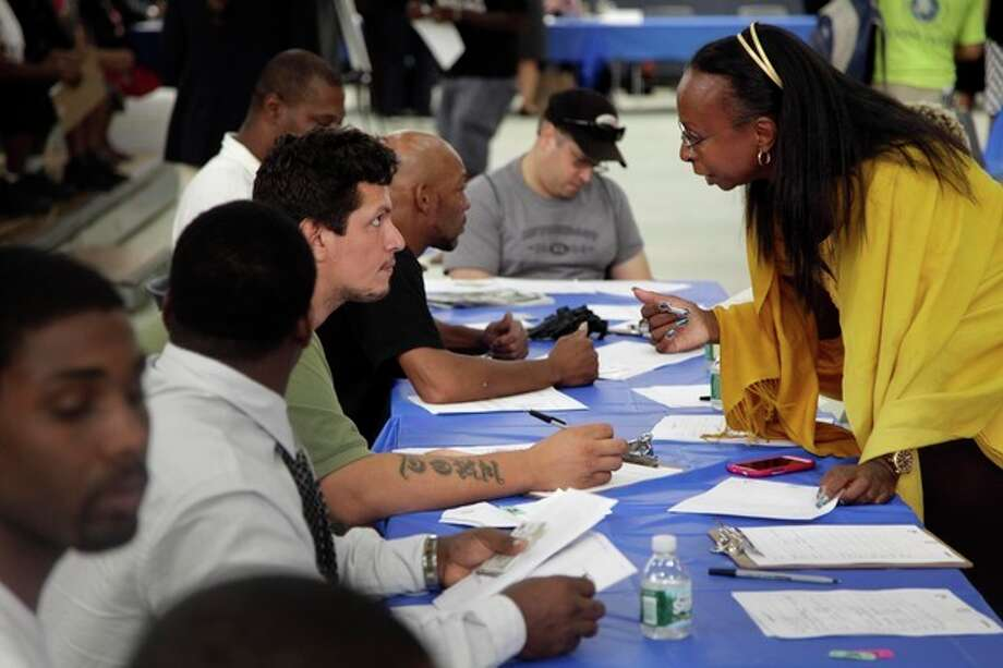 FILE - In this Tuesday, Aug. 21, 2012 file photo, job seekers fill out applications at a construction job fair in New York. U.S. employers added 96,000 jobs last month, the Labor Department said Friday, Sept. 7, 2012, a weak figure that could slow any momentum President Barack Obama hoped to gain from his speech to the Democratic National Convention. (AP Photo/Seth Wenig, File) / AP