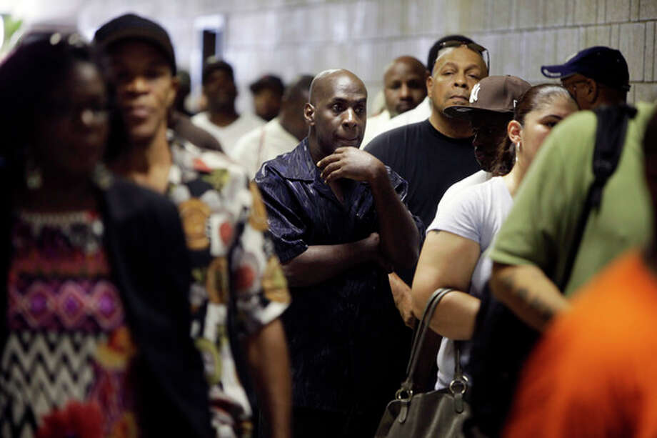 FILE - In this Tuesday, Aug. 21, 2012 file photo, job seekers wait in line at a construction job fair in New York. U.S. employers added 96,000 jobs last month, the Labor Department said Friday, Sept. 7, 2012, a weak figure that could slow any momentum President Barack Obama hoped to gain from his speech to the Democratic National Convention. (AP Photo/Seth Wenig, File) / AP