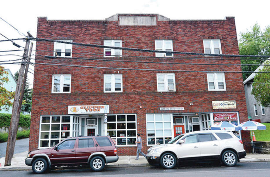 The Devisa building at 113-115 Nain St. was recently sold.Hour photo / Erik Trautmann / (C)2012, The Hour Newspapers, all rights reserved