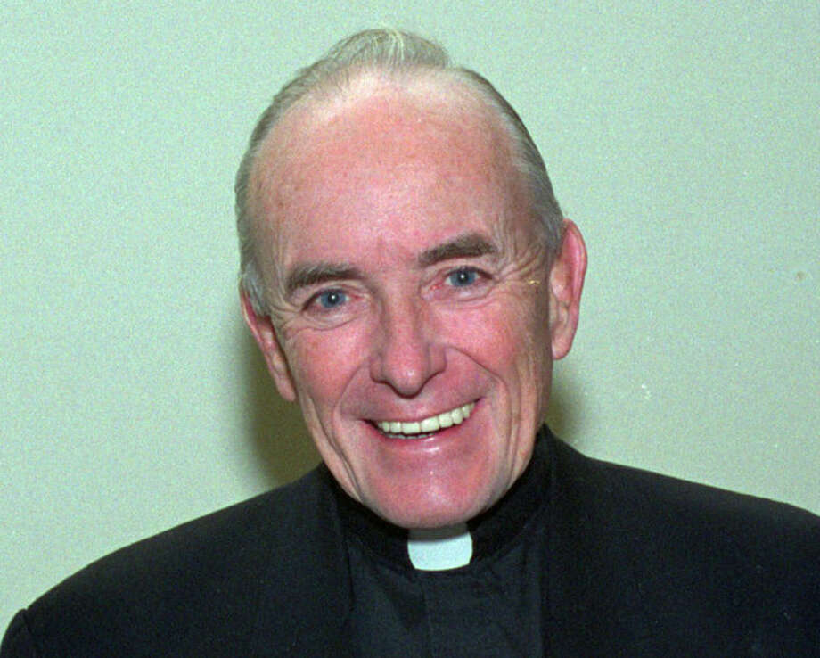 FILE - This 1992 file photo shows Rev. Andrew Greeley, an outspoken Roman Catholic priest, prolific best-selling novelist and Chicago newspaper columnist whose career spanned five decades. His longtime publicist said that Greeley died Wednesday, May 29, 2013, at his home in Chicago. He was 85. (AP Photo/File)