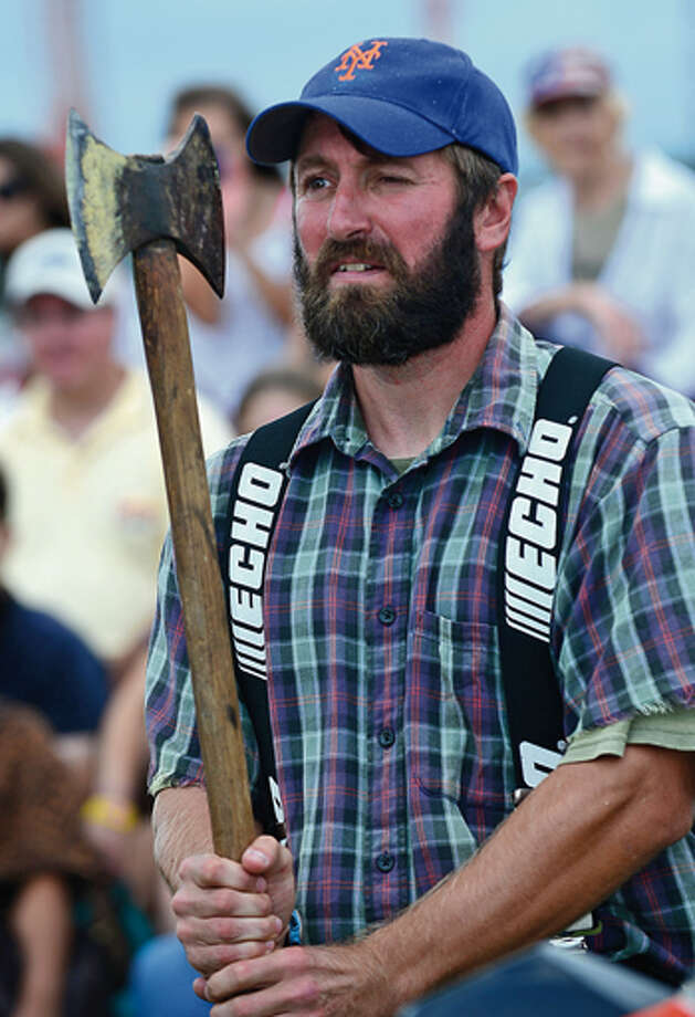 Webb Beckstead of the Paul Bunyon Lumber Jack Show aims his axe during the Norwalk Seaport Association 2012 Oyster Festival at Veteran's Memorial Park in Norwalk Saturday. Hour photo / Erik Trautmann / (C)2012, The Hour Newspapers, all rights reserved