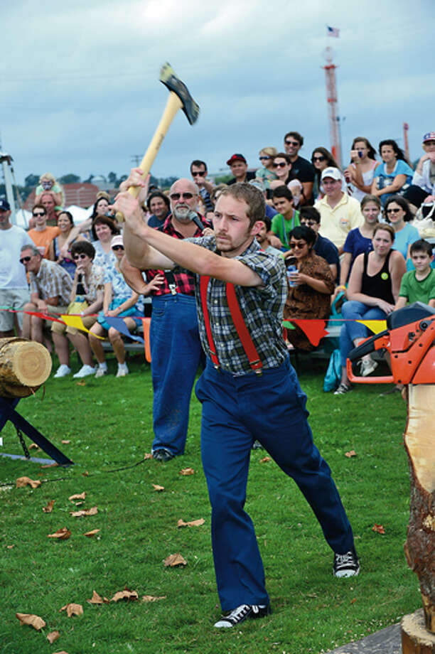 Jordan Beckstead of the Paul Bunyon Lumbe Jack Show trhow axes during the Norwalk Seaport Association 2012 Oyster Festival at Veteran's Memorial Park in Norwalk Saturday. Hour photo / Erik Trautmann / (C)2012, The Hour Newspapers, all rights reserved