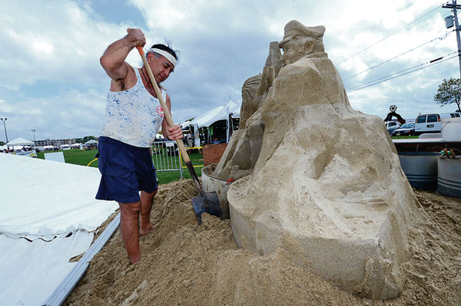 Alan Matsumoto builds a sand sculpture during the Norwalk Seaport Association 2012 Oyster Festival at Veteran's Memorial Park in Norwalk Saturday. Hour photo / Erik Trautmann / (C)2012, The Hour Newspapers, all rights reserved