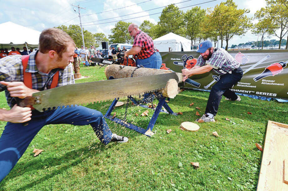 Hour photo / Erik TrautmannJordan Beckstead, Lee Le Captain and Webb Beckstead compete in The Paul Bunyan Lumberjack show during the Norwalk Seaport Association's 2012 Oyster Festival at Veterans Memorial Park in Norwalk Saturday. / (C)2012, The Hour Newspapers, all rights reserved