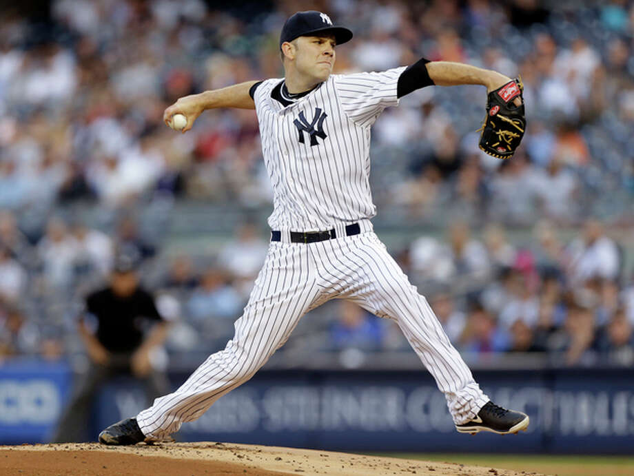 New York Yankees pitcher David Phelps delivers in the first inning of a baseball game against the Cleveland Indians at Yankee Stadium in New York, Tuesday, June 4, 2013. (AP Photo/Kathy Willens) / AP