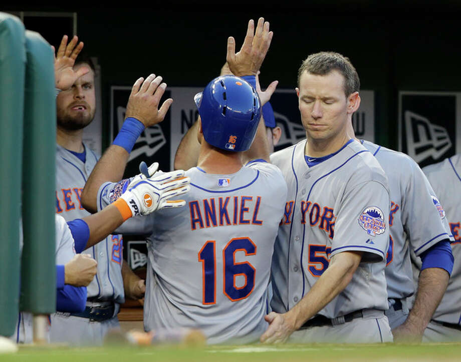 New York Mets' Rick Ankiel (16) celebrates scoring during the fifth inning of a baseball game against the Washington Nationals at Nationals Park Tuesday, June 4, 2013, in Washington. (AP Photo/Alex Brandon) / AP