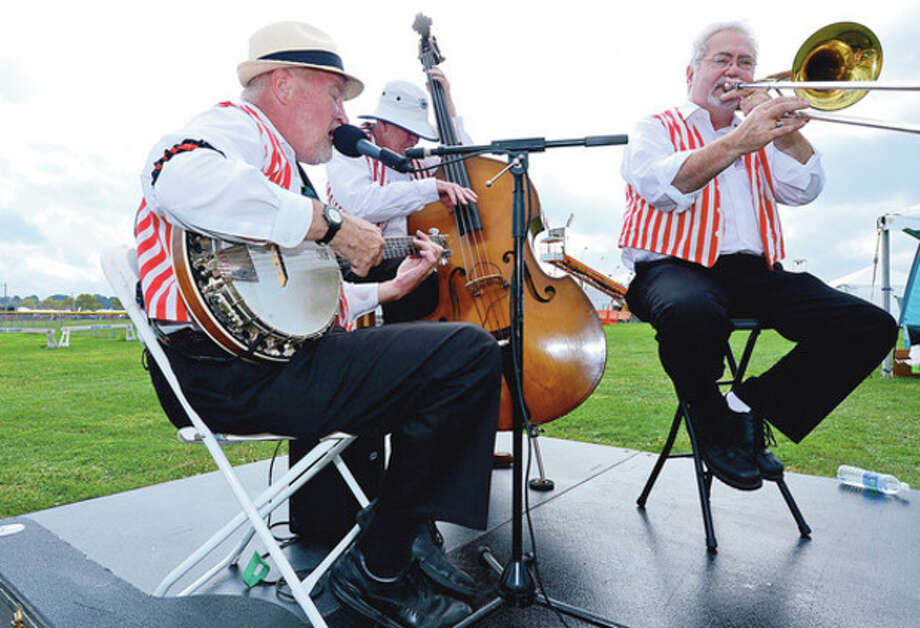 The Muscrat Banjo Band play during the Norwalk Seaport Association 2012 Oyster Festival at Veteran's Memorial Park in Norwalk Saturday.Hour photo / Erik Trautmann / (C)2012, The Hour Newspapers, all rights reserved