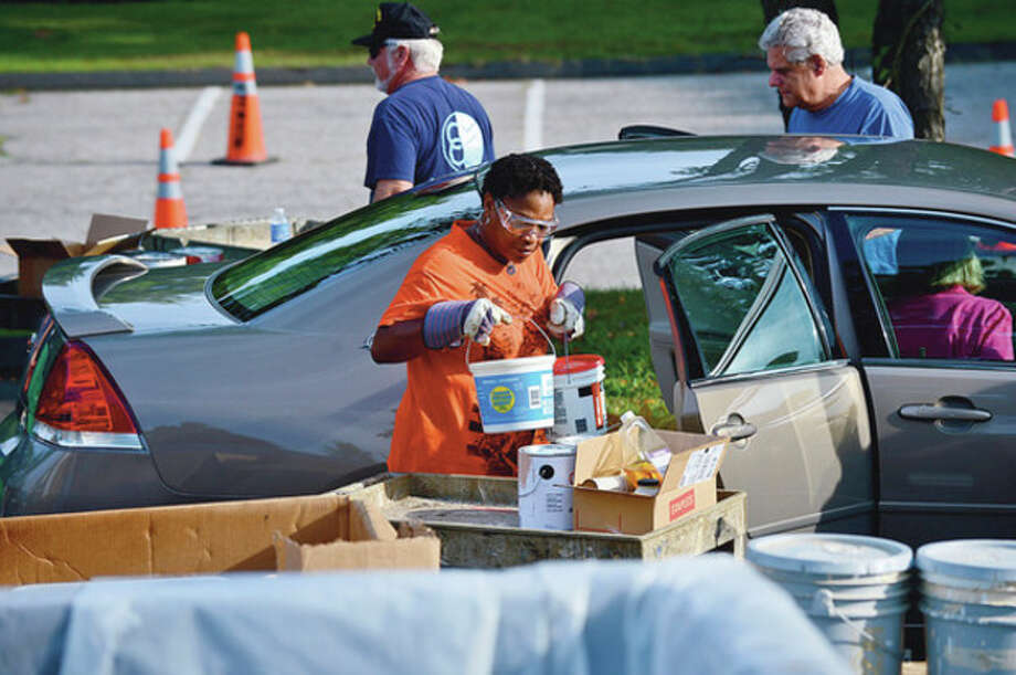 Workers with Care Enviromental Corporation unload hazardous materials for Norwalk residents during the annual collection at Norwalk High School Saturday.Hour photo / Erik Trautmann / (C)2012, The Hour Newspapers, all rights reserved