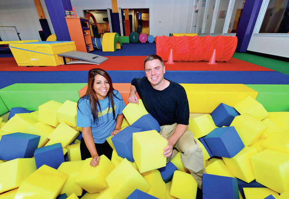 Hour photo / Erik TrautmannJedd Morin and Kim Nezvesky have opened Tumble Jungle in the County Mall on Westport Ave. in Norwalk. Below, some of the inflatable slides at the facility. / (C)2012, The Hour Newspapers, all rights reserved