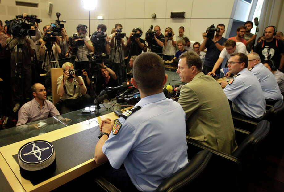 Annecy prosecutor Eric Maillaud, center, speaks during a news conference in Annecy, France, Friday, Sept. 7, 2012. Maillaud said that the 4-year-old girl who survived the slaying of her family in Annecy couldn't help their investigation since she hid under her mother's legs during the killings. (AP Photo/Lionel Cironneau) / AP