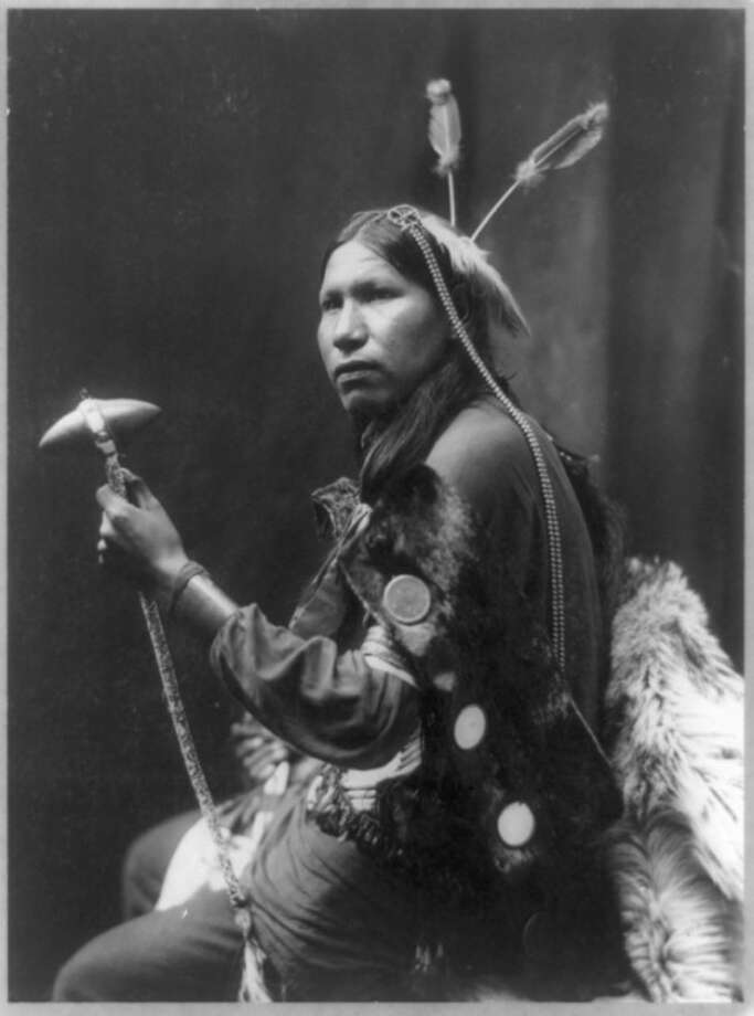This 1899 portrait by George Heyn, provided by The Library of Congress, shows Albert of Afraid of Hawk holding a tomahawk. More than a century after dying from food poisoning while touring New England with Buffalo Bill's Rough Riders, Afraid of Hawk's remains are returning from Danbury, Conn., to South Dakota where he will be buried with tribal members. The Oglala Sioux Tribe is planning a traditional Lakota funeral service on the Pine Ridge Indian Reservation on Sunday, Sept. 9, 2012. (AP Photo/Library of Congress, George Heyn)