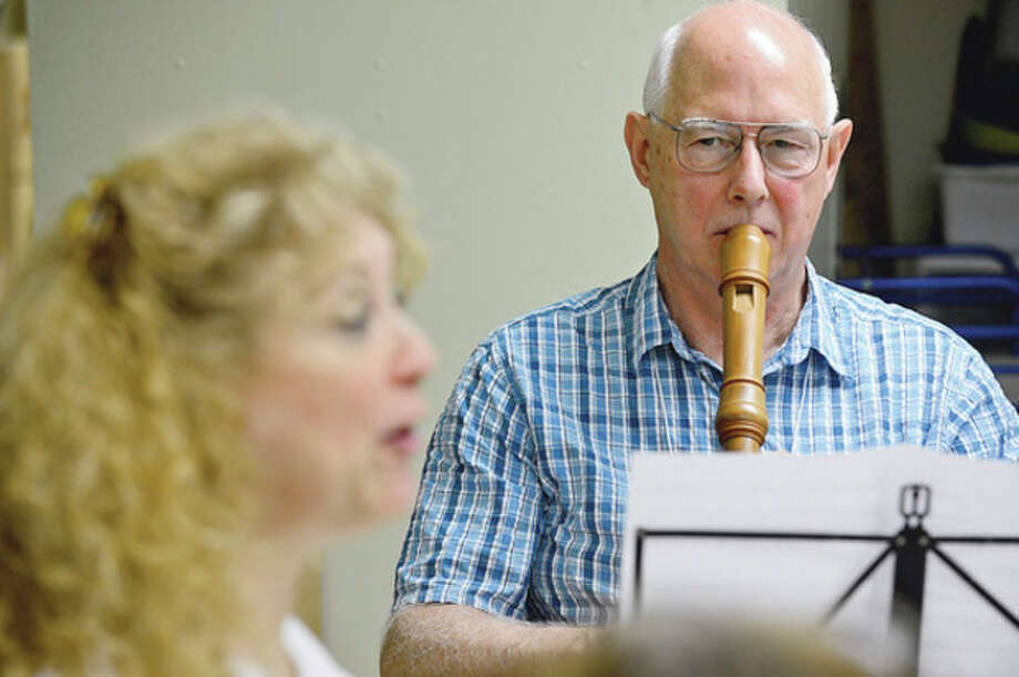 Hour photo / Erik TrautmannMembers of the Recorder Society of CT, including John van der Meulen, practice at the Unitarian Church in Westport Saturday during their weekly meeting. / (C)2012, The Hour Newspapers, all rights reserved