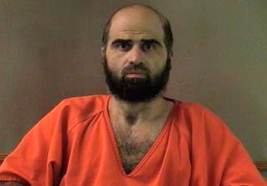 FILE - This undated file photo provided by the Bell County Sheriff's Department shows Nidal Hasan, the Army psychiatrist charged in the deadly 2009 Fort Hood shooting rampage that left 13 dead. Hasan will represent himself at his upcoming murder trial, meaning he will question the more than two dozen soldiers he's accused of wounding, a military judge ruled Monday, June 3, 2013. (AP Photo/Bell County Sheriff's Department, File) / Bell County Sheriff's Department