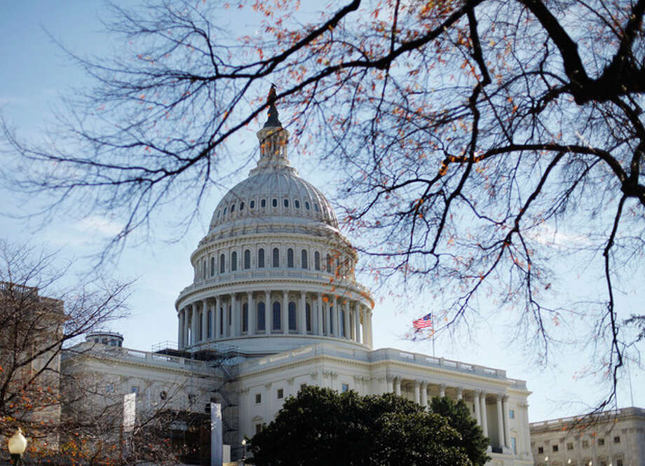 FILE - In this Nov. 19, 2011 fie photo the U.S. Capitol building is seen in Washington. Fresh off a five-week vacation, lawmakers return to Washington on Monday, Sept. 10, 2012, for a brief pre-election session in which Congress will do what it often does best: punt its problems to the future. At issue is a six-month temporary spending bill to finance the day-to-day operations of the federal government. (AP Photo/Pablo Martinez Monsivais, File) / AP