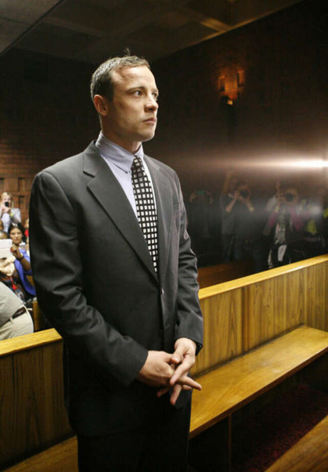 Oscar Pistorius appears in the magistrates court in Pretoria, South Africa, Tuesday, June 4, 2013. Pistorius is back in the glare of public scrutiny for the first time in months, launching the next chapter of a sensational case that transformed the double-amputee Olympian from a smiling global inspiration to a sobbing suspect facing a life sentence in prison if convicted of killing his girlfriend. (AP Photo/Themba Hadebe)