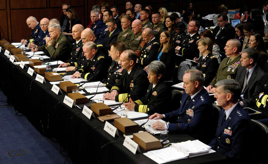 Joint Chiefs Chairman Gen. Martin Dempsey, testifies on Capitol Hill in Washington, Tuesday, June 4, 2013, before the Senate Armed Services Committee hearing on pending legislation regarding sexual assaults in the military. At the witness table, from left are, Judge Advocate General of the Coast Guard Rear Adm. Frederick J. Kenney Jr.; Coast Guard Commandant Adm. Robert J. Papp Jr.; Staff Judge Advocate to the Marine Corps Commandant Maj. Gen. Vaughn A. Ary; Marine Corps Commandant Gen. James F. Amos; Judge Advocate General of the Army Lt. Gen. Dana K. Chipman; Army Chief of Staff Gen. Ray Odierno; Dempsey; Legal Counsel to the Chairman of the Joint Chiefs of Staff Brig. Gen. Richard C. Gross; Chief of Naval Operations Adm. Jonathan W. Greenert; Judge Advocate General of the Navy Vice Adm. Nanette M. DeRenzi; Air Force Chief of Staff Gen. Mark A. Welsh III; and Judge Advocate General of the Air Force Lt. Gen. Richard C. Harding. (AP Photo/Susan Walsh) / AP
