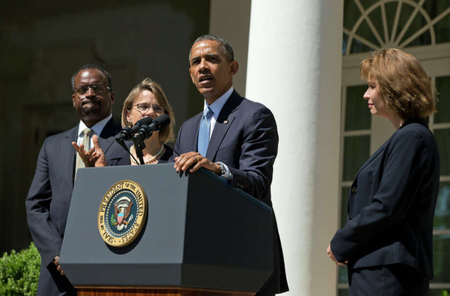 President Barack Obama speaks in the Rose Garden of the White House in Washington, Tuesday, June 4, 2013, to announced the nominations of, from left, Robert Wilkins, Cornelia Pillard, and Patricia Ann Millet, to the federal appeals court in Washington. (AP Photo/Evan Vucci) / AP