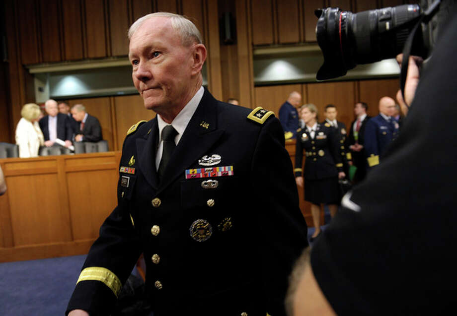 AP Photo/Susan WalshJoint Chiefs Chairman Gen. Martin Dempsey arrives on Capitol Hill in Washington, Tuesday, June 4, 2013, to to testify before the Senate Armed Services Committee hearing on pending legislation regarding sexual assaults in the military. Determined to stop sexual assault in the military, Congress is spelling out for the services how far lawmakers are willing to go in changing the decades-old military justice system. / AP