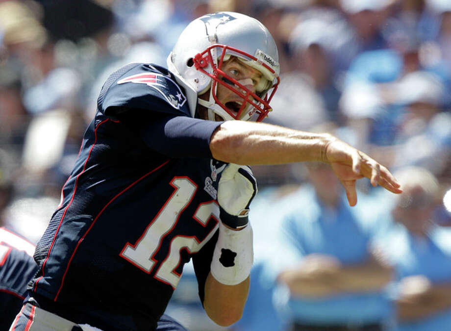 New England Patriots quarterback Tom Brady passes against the Tennessee Titans in the second quarter of an NFL football game on Sunday, Sept. 9, 2012, in Nashville, Tenn. (AP Photo/Wade Payne) / FR23601 AP