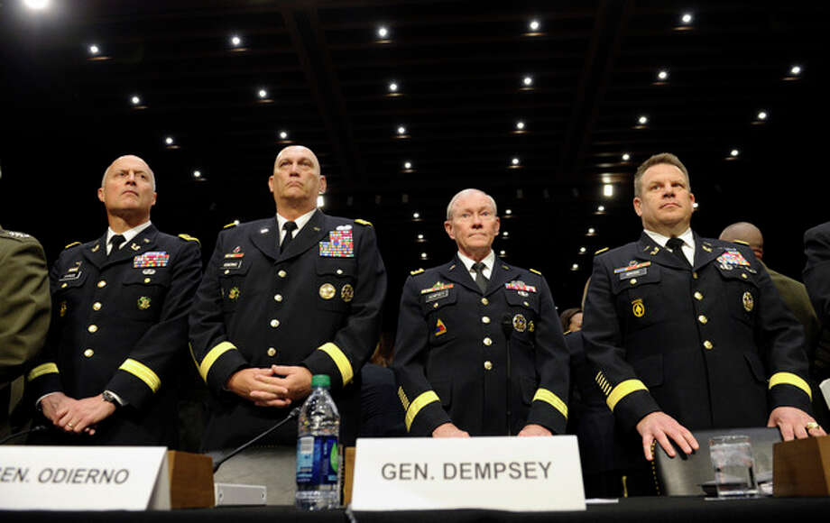 From left, Judge Advocate General of the Army Lt. Gen. Dana Chipman; Army Chief of Staff Gen. Ray Odierno; Joint Chiefs Chairman Gen. Martin Dempsey; and Legal Counsel to the Chairman of the Joint Chiefs of Staff Brig. Gen. Richard Gross, arrive on Capitol Hill in Washington, Tuesday, June 4, 2013, to testify before the Senate Armed Services Committee hearing on pending legislation regarding sexual assaults in the military. (AP Photo/Susan Walsh) / AP