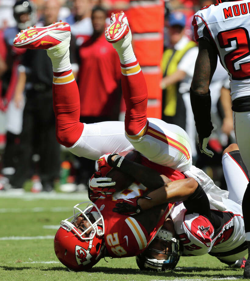 Kansas City Chiefs wide receiver Dwayne Bowe (82) is tackled by Atlanta Falcons cornerback Brent Grimes (20) during the first half of an NFL football game at Arrowhead Stadium in Kansas City, Mo., Sunday, Sept. 9, 2012. (AP Photo/Ed Zurga) / FR34145 AP